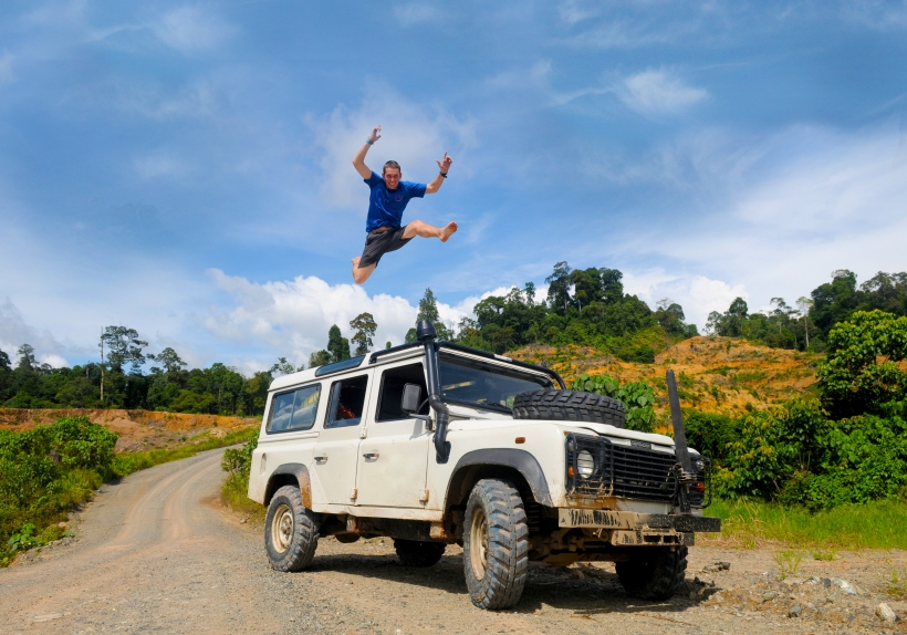 Man Jumping On Top Of 4x4 Car In Celebration