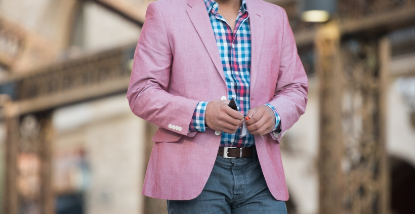 Man Wearing Casual Pink Jacket And Smartphone Walking